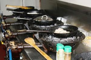 Inside Trattoria Uma's kitchen.
