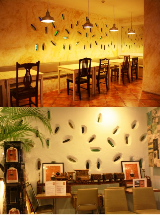 Separated by bottles. The upper photo is the Trattoria Uma portion while the lower photo is taken inside Cafe Uma.