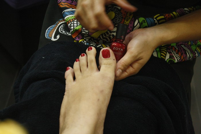 Red sparkling toes and a pair of feet ready to explore.